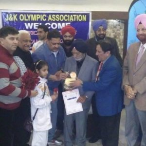 Syed Baseerat receiving certificate and trophy at Amar singh club, Jammu with Olympic president and other members